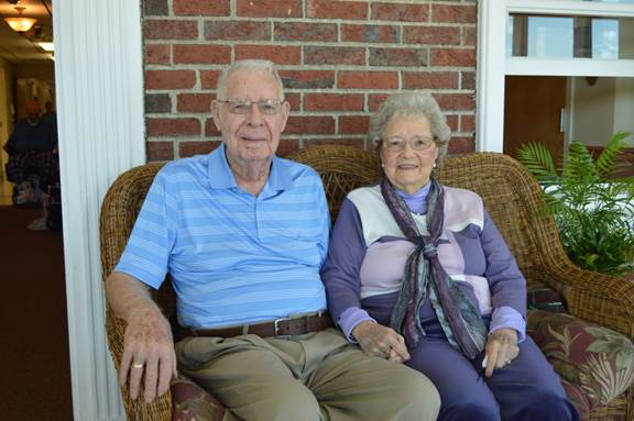 Delbert and Wilda McCrum sit together on the patio at the Aroostook Health Center in Mars Hill. On Tuesday, their 71st anniversary, the staff at AHC threw them a party.