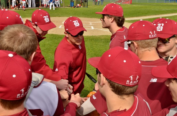 Bangor High School head baseball coach Jeff Fahey gives last-minute instruction before his team takes the field against Messalonskee High School in Oakland recently.