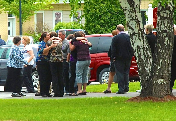 Friends and family of Amy Theriault comfort each other after her funeral Thursday afternoon in Fort Kent.