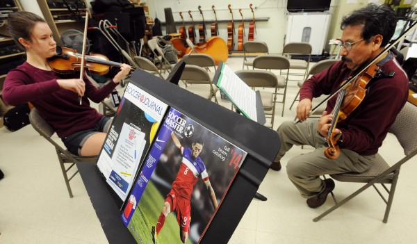 Waldo Caballero is pictured with violin student Annika Gallandt during a lesson on Friday at Orono High School.