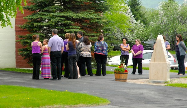 Family, friends and co-workers of Amy Theriault, 31, wore purple -- the color of domestic violence awareness -- to her funeral Thursday.