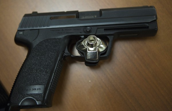A trigger lock is placed on a gun seen Wednesday at the Bangor barracks of the Maine State Police.