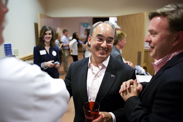 Bruce Poliquin, former state treasurer, talks with Brent Littlefield (right) along with other supporters of his campaign during election night at Dysarts in Bangor.