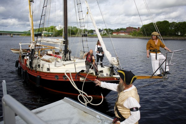 Syd &quotSyd Viskus&quot Leach (center) grabs a rope to tie off the Dark Rose pirate ship Friday afternoon on the Bangor Waterfront.