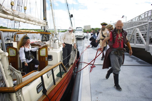 Kip &quotJack Lash Lannagin&quot Nelson (right) ties off a safety line while docking the Dark Rose pirate ship Friday afternoon on the Bangor Waterfront.