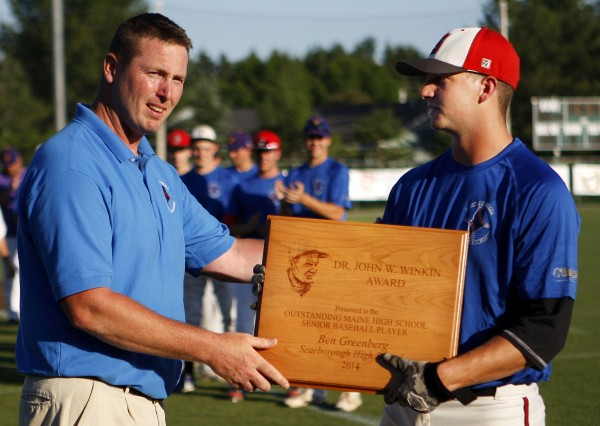 Nick Caiazzo, president of the Maine Baseball Coaches Association, left, awards Scarborough High School's Ben Greenberg with the Dr. John W. Winkin Award.