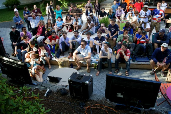 People gather to watch the United States play Ghana in the World Cup soccer tournament on televisions set up in Portland's Congress Square Monday night.