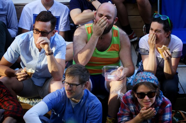 Soccer fans react to a nose injury while watching a World Cup soccer match on televisions in Portland's Congress Square Monday night.