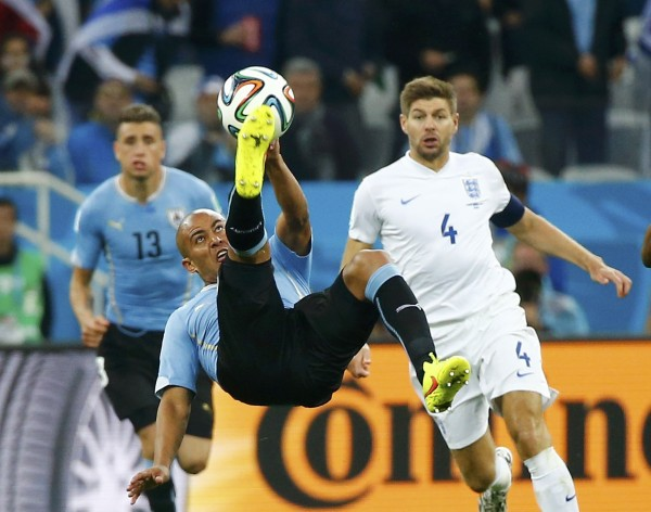 Uruguay's Egidio Arevalo Rios attempts a bicycle kick during Thursday's 2014 World Cup Group D soccer match between Uruguay and England at the Corinthians arena in Sao Paulo. Uruguay won 2-1.