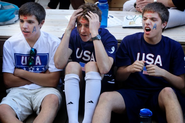 Baxter Academy classmates (from left) Benjamin Schmidt, Nathan Smail and Bryce Schmidt react to a play while watching the United States play Ghana in a World Cup soccer match on televisions in Portland's Congress Square Monday night.