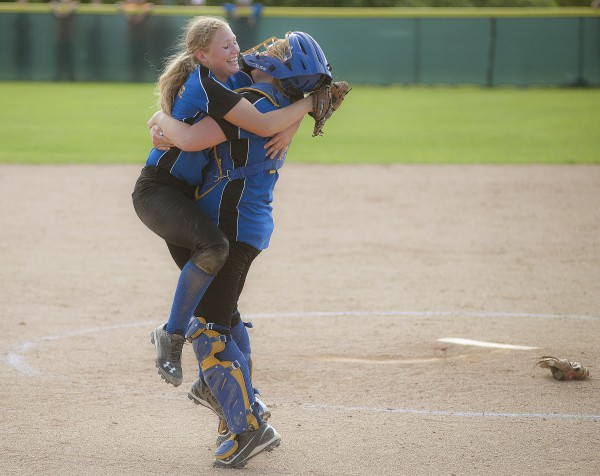 Hermon pitcher Karli Theberge (left) celebrates with catcher Shaniah Haskell Wednesday after the Hawks won the Eastern Maine Class B softball championship over Gardiner 6-1 in Brewer.