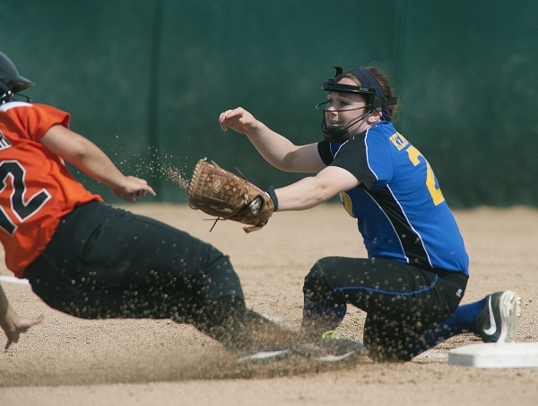 Hermon third baseman Kylie Kennedy (right) tries to get the tag on  Gardiner's Hope Dube-Grenier Wednesday in the Eastern Maine Class B softball championship in Brewer.