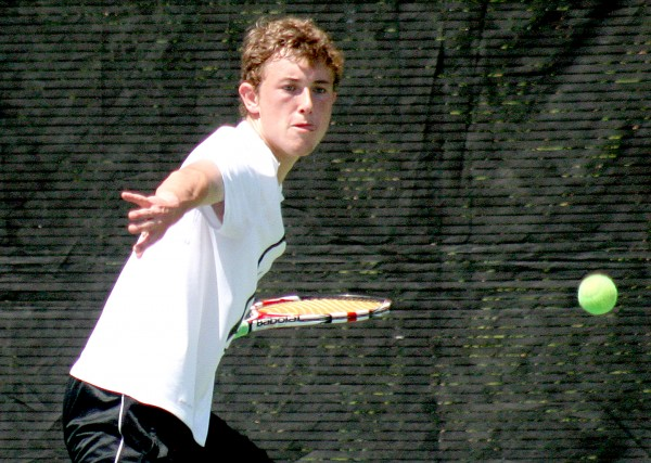 Brendan McCarthy of Falmouth returns a shot to Nick Mathieu of Mount Ararat during the final match of the 2014 MPA singles championship Monday at Bates College in Lewiston. McCarthy win the match, 6-1, 6-2.