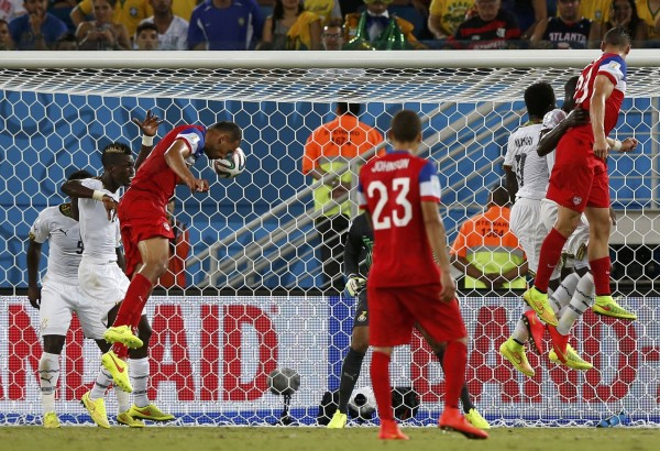 John Brooks of the U.S. (third from left) heads the ball to score a goal against Ghana during their 2014 World Cup Group G soccer match at the Dunas arena in Natal, Brazil, Monday.