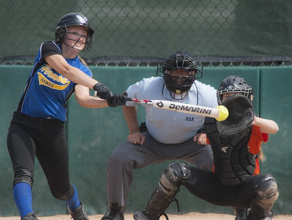 Hermon batter Karli Theberge is just late on a pitch Wednesday in the second inning of the Eastern Maine Class B softball championship game against Gardiner in Brewer.