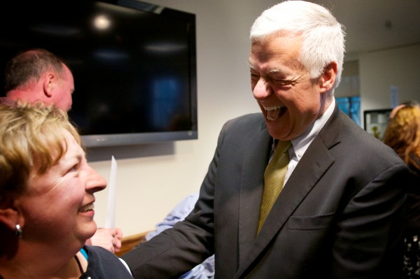 U.S. Rep. and Democratic gubernatorial candidate Mike Michaud laughs with a supporter after unveiling his campaign plan to create an Office of Inspector General.