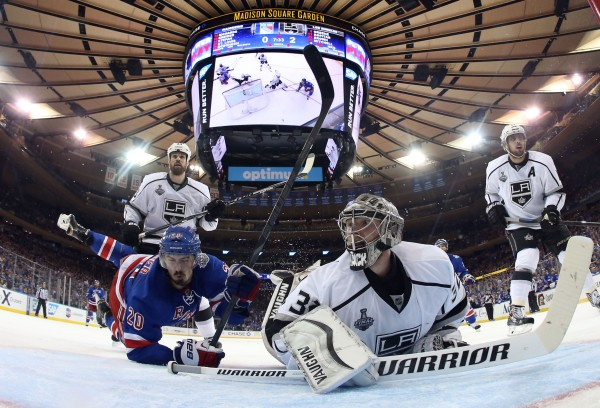 Los Angeles Kings goalie Jonathan Quick (32) and New York Rangers left wing Chris Kreider (20) look back for the puck as they collide during the second period in game three of the 2014 Stanley Cup Finals at Madison Square Garden in New York Monday night.