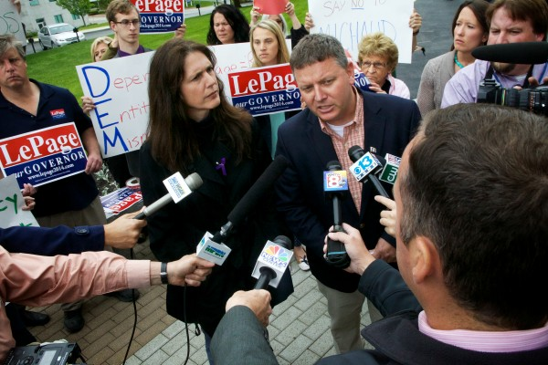Senate minority leader Mike Thibodeau, R-Winterport, and Rep. Deborah Sanderson, R-Chelsea, speak outside the State House on Thursday in response to U.S. Rep. Mike Michaud's campaign plan to create an Office of Inspector General.
