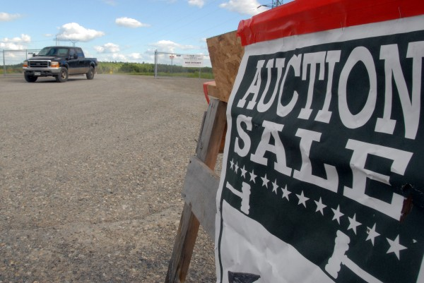 An auction sale sign at the Millinocket mill site on June 19.