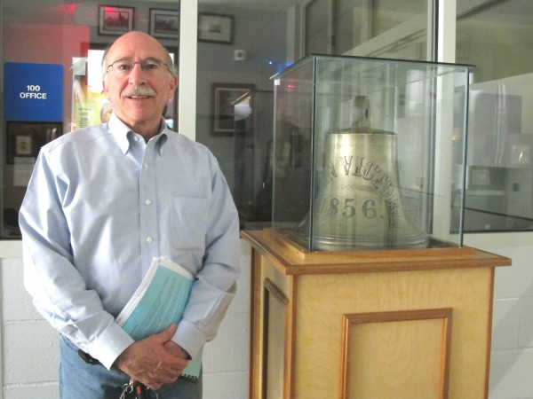 Roger Bowen, selectman in the town of Gouldsboro, stands next to the town's famous bell on Wednesday night after local voters approved a proposal to lend the bell to the Canadian Museum of History. &quotI couldn't be happier,&quot said Bowen, who was in favor of making the loan.