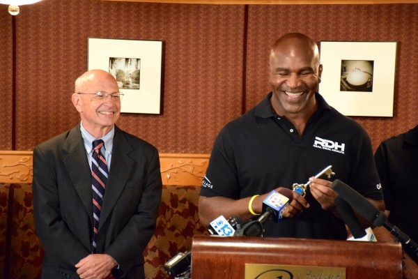 Portland Mayor Michael Brennan (left) presented five-time former heavyweight champion Evander Holyfield (right) a key to the city this afternoon. Holyfield will be a special guest at the All Star Boxing Event at the Portland Expo Center tomorrow night.