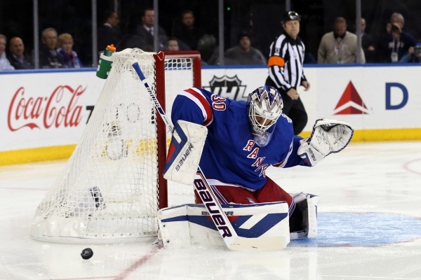 New York Rangers goalie Henrik Lundqvist makes a save against the Los Angeles Kings on Wednesday night during the first period in Game 4 of the 2014 Stanley Cup Final at Madison Square Garden. The Rangers won 2-1.