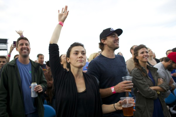 Elsa Wedge (left) and P. A. Parenteau, a NHL right winger for the Colorado Avalanche, cheer during the Dave Matthews Band performance Friday evening at the Darling's Waterfront Pavilion in Bangor.
