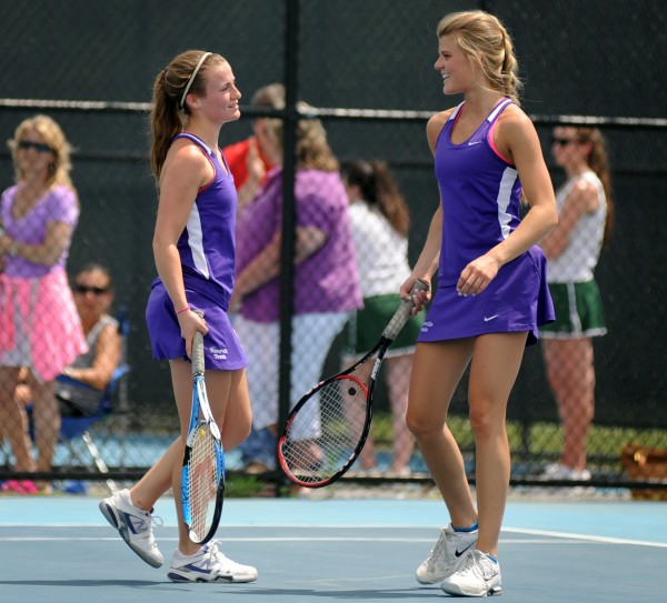 Waterville's Jayme Saulter (left) and Emma Cristan defeated Sierra Bloom and MacKenzie Myers of Mount Desert Island in the first singles match at the Eastern Maine Class B tennis championship on Wednesday at Colby College in Waterville.