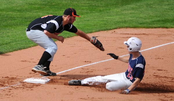 Bangor Christian's Seth Pearson (right) slides safely to third past Limestone's Tyler Morgan on Wednesday during the Eastern Maine Class D baseball final at Mansfield Stadium in Bangor.