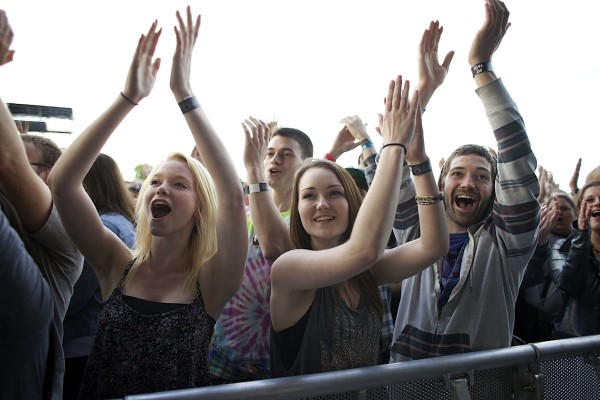 Trynity Plummer (from left), Dakota Jenkins and Wyatt Jenkins of Houlton cheer after the Dave Matthews Band performed &quotTwo Step&quot with Tim Reynolds on Friday evening at the Darling's Waterfront Pavilion in Bangor.