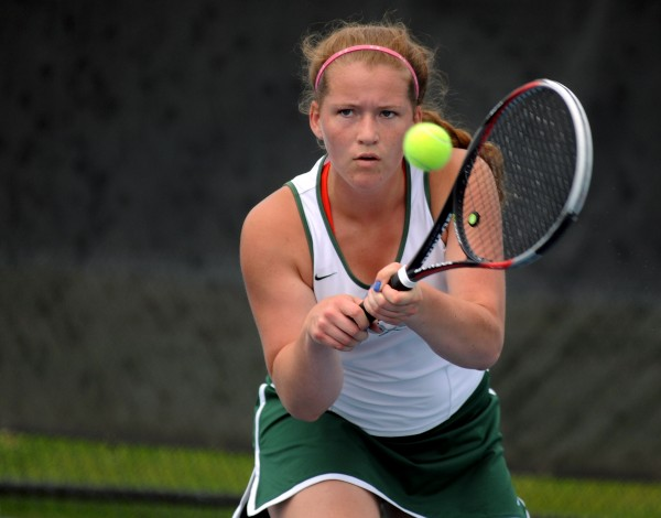 MDI's Madeline Cook competes against Waterville's Colleen O'Donnell in the girls No. 1 singles at the Eastern Maine Class B team tennis championship on Wednesday at Colby College in Waterville. O'Donnell won  6-0, 6-0.
