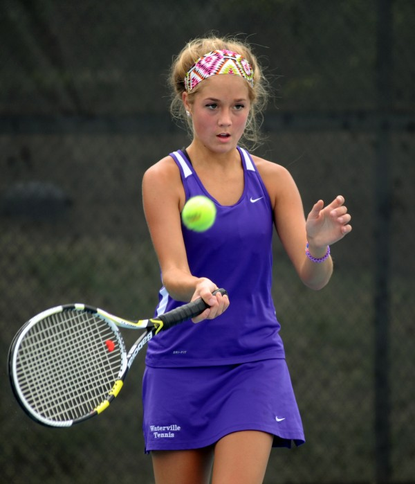 Waterville's Colleen O'Donnell returns the ball to MDI's Madeline Cook during the Eastern Maine Class B team tennis championship on Wednesday at Colby College in Waterville.