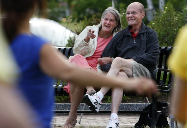 Don (right) and Dora Winslow watch as a flash mob of dancers unfolds in front of them on Tuesday at the Bangor Waterfront. The community decided to show their support of Don, a retired Bangor police chief, who recently decided to stop treatment on his cancer.