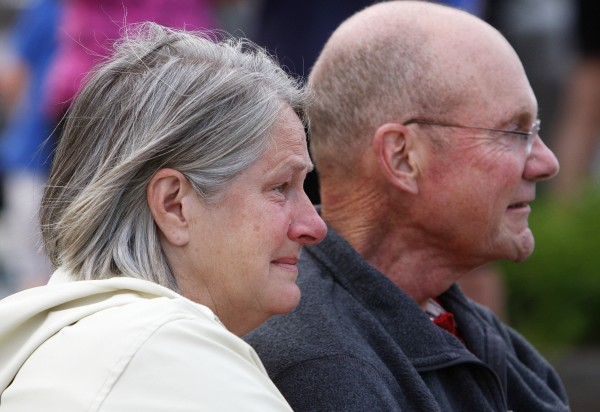 A teary eyed Dora Winslow (left) watches with her husband, Don Winslow, as a flash mob in honor of Don unfolds in front of them on Tuesday at the Bangor Waterfront. The community decided to show their support of Don, a retired Bangor police chief, who recently decided to stop treatment on his cancer.
