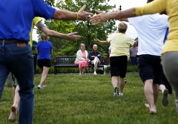 Don (right) and Dora Winslow watch as a flash mob dances in front of them on Tuesday at the Bangor Waterfront. The community decided to show their support of Don, a retired Bangor police chief, who recently decided to stop treatment on his cancer.