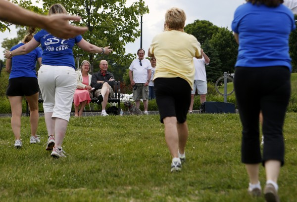 A flash mob dances in front of Don (right) and Dora Winslow on Tuesday at the Bangor Waterfront. The community decided to show their support of Don, a retired Bangor police chief, who recently decided to stop treatment on his cancer.