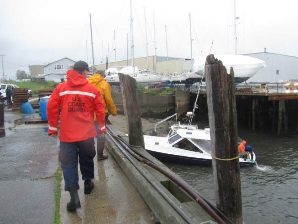 A speedboat is grounded next to the Rockland Fish Pier after nearly sinking at its mooring early Friday evening.