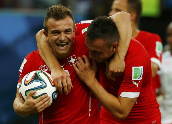 Switzerland's Xherdan Shaqiri (L) celebrates with Josip Drmic after Shaqiri's hat trick led the team past Honduras in Wednesday's World Cup soccer match at Manaus, Brazil.