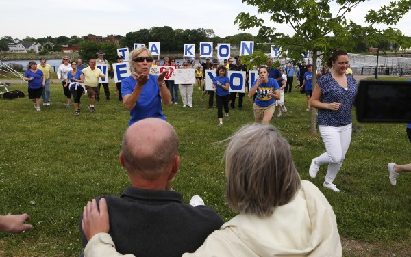 Don (left) and Dora Winslow watch as a flash mob dances in front of them on Tuesday at the Bangor Waterfront. The community decided to show their support of Don, a retired Bangor police chief, who recently decided to stop treatment on his cancer.