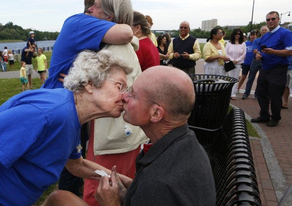 Wanda Winslow (left) gives her son Don Winslow a kiss after a flash mob in Don's honor on Tuesday at the Bangor Waterfront. The community decided to show their support of Don, a retired Bangor police chief, who recently decided to stop treatment on his cancer.