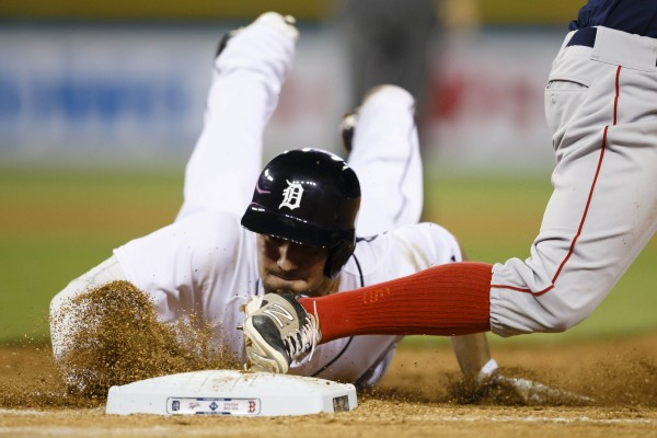Detroit's Nick Castellanos is out at first on a line-drive double play as he tries to dive back during the eighth inning against the Boston Red Sox at Comerica Park in Detroit Friday night.