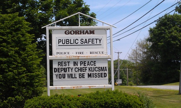 The Gorham public safety building sign pays tribute to fallen firefighter Michael Kucsma.