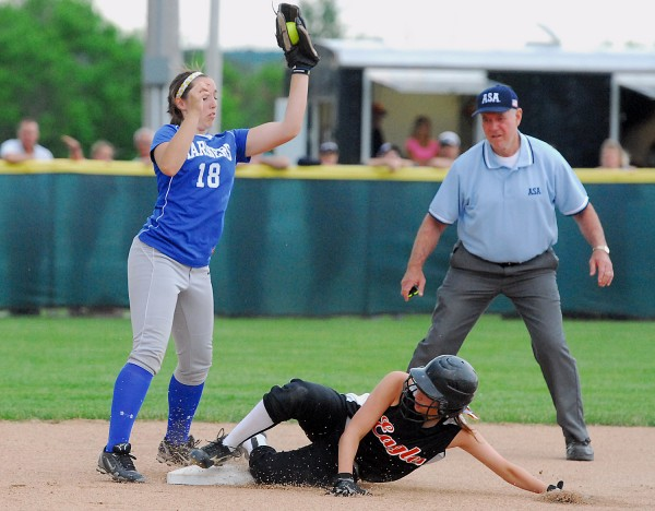 Limestone's Jackie Peers beats the throw to Deer Isle-Stonington's Morgan Shepard for a steal of second base during the Eastern Maine Class D softball final Wednesday night at Coffin Field in Brewer.