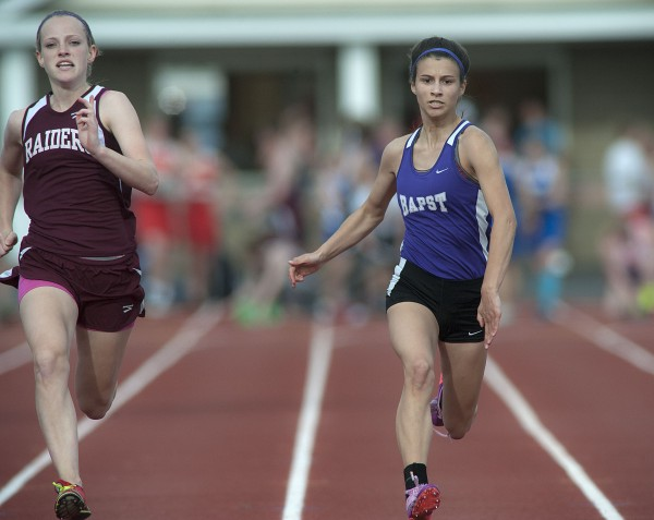 ohn Bapst Memorial High School's Katie Cotton (right) competes in the girls 100-meter dash during the PVC Small School Track and Field Championships in Dover-Foxcroft on Monday.