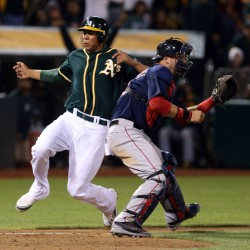 Crisp's game-ending sacrifice fly lifts A's by Red Sox