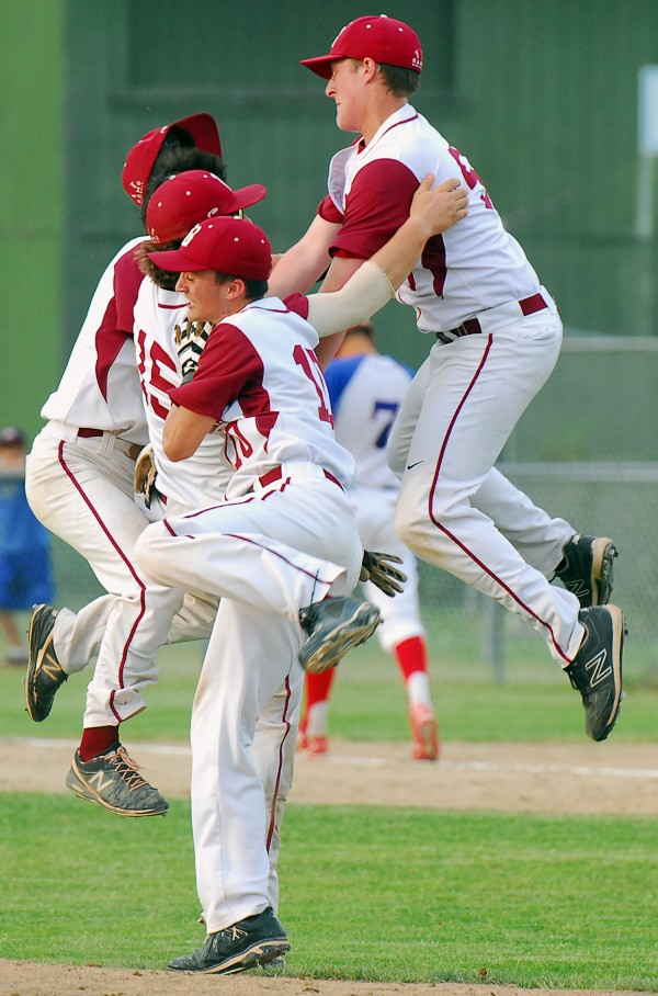 Bangor High School's Johnny Cote (center) and Andrew Hillier (right) take to the air to celebrate with teammates after beating Messalonskee 6-3 for the Eastern Maine Class A title Tuesday at Morton Field in Augusta.