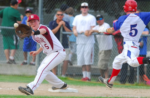 Bangor High School first baseman Andrew Hillier fields a throw to force out Messalonskee's Trevor Gettig during fifth-inning action of the Eastern Maine Class A final Tuesday at Morton Field in Augusta.