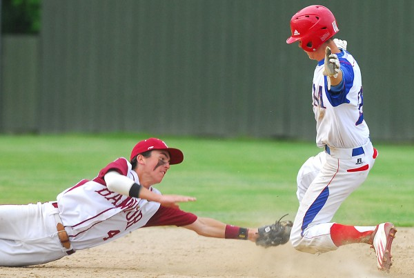 Bangor High School's shortstop Kyle Stevenson comes up just short of tagging out Messalonskee's Devin Warren at second base in the sixth inning of the Eastern Maine Class A final Tuesday at Morton Field in Augusta.