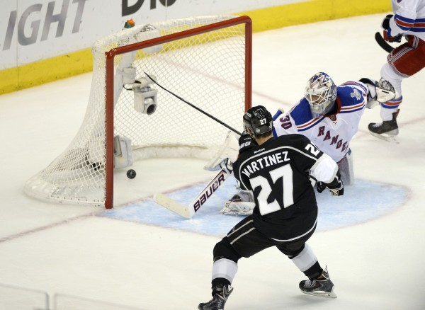 Los Angeles Kings defenseman Alec Martinez (27) scores the game-winning goal past New York Rangers goalie Henrik Lundqvist (30) during the second overtime period in game five of the 2014 Stanley Cup Finals at Staples Center in Los Angeles Friday night.
