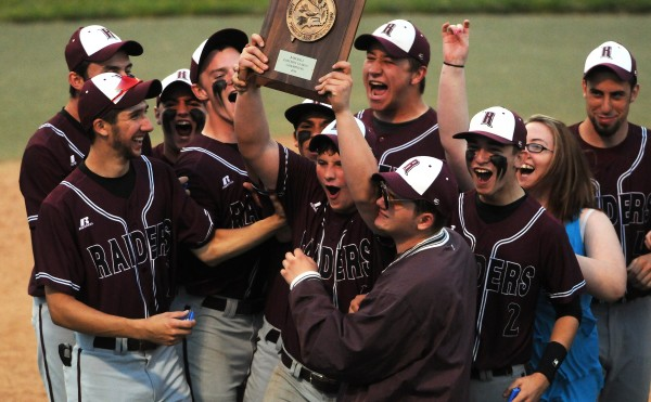 BANGOR, MAINE -- 06/17/14 -- Washington Academy's Frederick MacLean (center) holds up the championship trophy after defeating George Stevens Academy during their Eastern Maine Class C baseball final at Mansfield Stadium Tuesday. Washington Academy won 3-0.